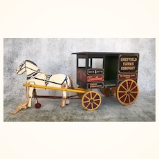 Antique wooden advertising toy milk cart and horse