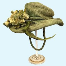 Wonderful green doll's hat with flocked bud trim and feathers