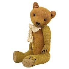 Very old well loved mohair teddy bear