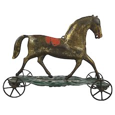 Antique American tin horse on wheels pull toy