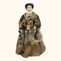 Antique papier mache peddler doll
