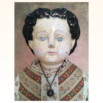 Antique papier mache doll
