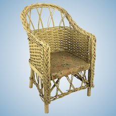 Old yellow painted wicker chair for doll