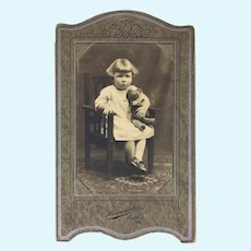 Antique Sepia tone photo of little girl and teddy bear