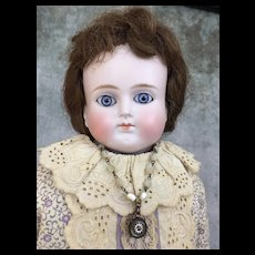 Antique turned head German bisque beauty