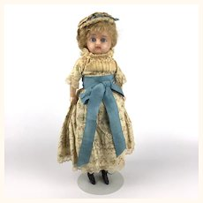 Antique German wax over girl with blue glass eyes