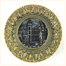 Antique large brass button with architectural image center