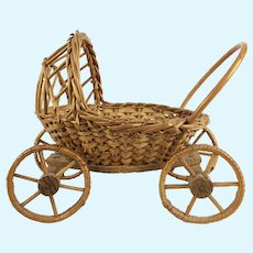 Vintage wicker doll stroller or carriage