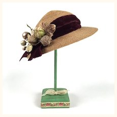 Vintage straw doll hat with velvet ribbon and flowers