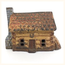 Vintage John Wright cast iron Log Cabin still bank