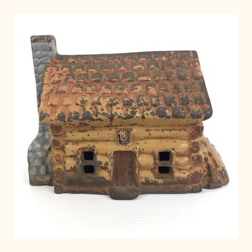 Vintage John Wright cast iron Log Cabin still bank