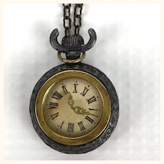 Antique doll's watch on chain