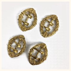 Four beautiful ornate small buckles for doll's clothing