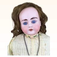 German bisque head doll with striking blue eyes
