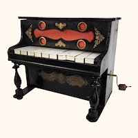 Antique French toy piano with xylophone and music box