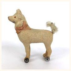 Antique papier mache dog on wheels