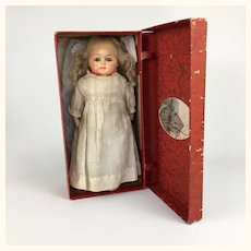 Small antique papier mache doll in box