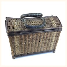 Antique lidded wicker basket with leather handles