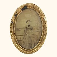 Antique sepia tone mid 19th century photo in ormolu frame