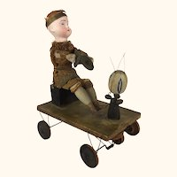 Antique bisque head boy with cymbals on pull toy