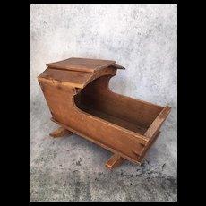 Vintage rustic wooden doll cradle