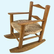 Vintage wood and rattan doll sized rocking chair