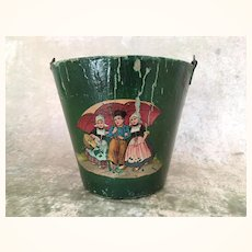 Old pressed paper child's bucket with Dutch children