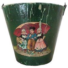 Old pressed paper child's bucket with Dutch children