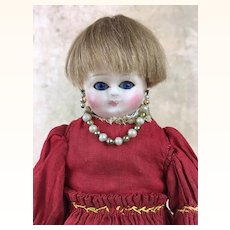Antique small wax over papier mache doll