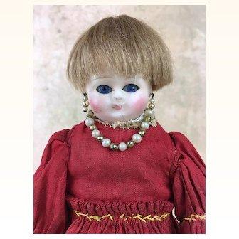 Antique small wax over papier mache doll