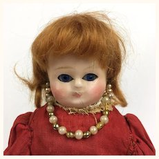 Antique 10 inch wax over papier mache doll in red dress