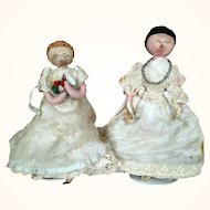 Two folk art lady dolls of wrapped wire in fabulous clothing