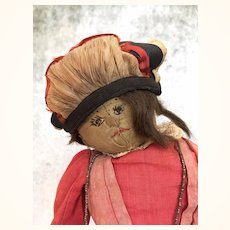 Unusual cloth folk art doll with fabulous shoes