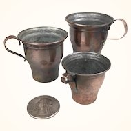 Tin lined copper cups, set of three