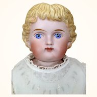 Beautiful blonde tinted bisque doll