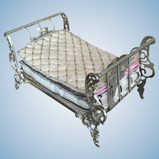 Antique ornate soft metal bed with handmade mattress and silk bedding
