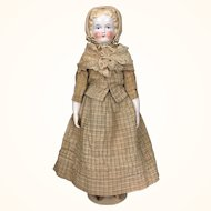 Antique china head modified flattop doll in wonderful clothing