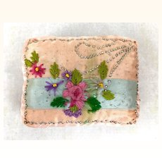 Vintage satin pincushion with embroidery and pin design