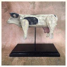 Vintage folk art carved painted wooden cow