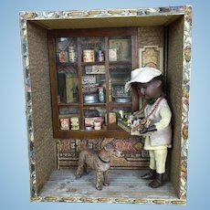 Old very unusual room box with boy, store and dog