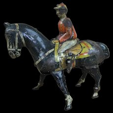 Antique or vintage wind up tin horse and jockey, doll toy