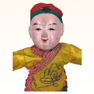 Papier mache Chinese boy doll