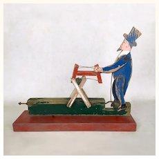 Old folk art toy, man sawing wood