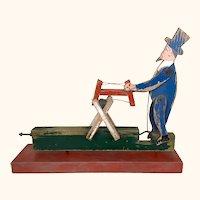 Antique folk art Americana man sawing wood whirlygig or steam toy