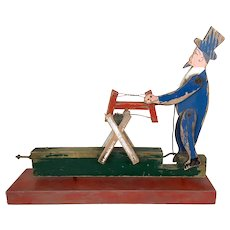 Antique folk art Americana man sawing wood whirlygig or steam toy