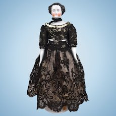 China head doll with flattop hair style and beautiful dress