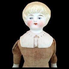 Blonde parian doll with decorated shoulder plate