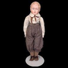Antique papier mache boy in charming clothing