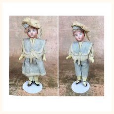 Pair of Sailor boy and girl dolls with provenance