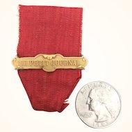 Antique bar pin on ribbon